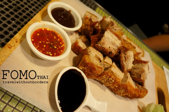 Roasted pork bellies served with three specialty condiments